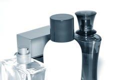 Bottle of perfume. Close-up on white background. Monochrome Stock Photos