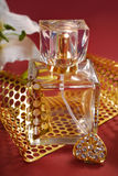 Bottle of perfume with gold decoration Stock Images