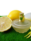 Bottle of perfume with lemon Stock Photo