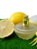 Bottle of perfume with lemon Stock Photo