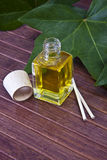 Bottle of perfume oil Stock Photography