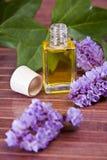 Bottle of perfume oil Stock Images