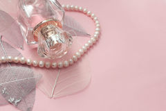Bottle of perfume on a pink background Royalty Free Stock Photos