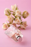 Bottle of perfume with roses Royalty Free Stock Images