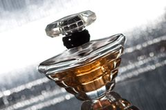Bottle of perfume on silver background Stock Images