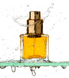 Bottle of perfume in a spray Stock Images