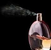 Bottle of perfume spraying Royalty Free Stock Photography