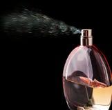 Bottle of perfume spraying Royalty Free Stock Photography