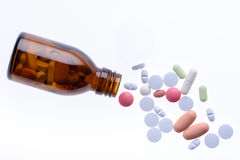 Bottle of pills and drugs. Pills from bottle on the white background Royalty Free Stock Photo