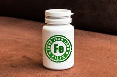 Bottle of pills with iron Royalty Free Stock Images