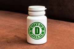 Bottle of pills with vitamin D Royalty Free Stock Photo