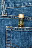 Bottle in a pocket Stock Photo