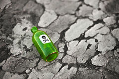Bottle on poisoned ground Stock Photo