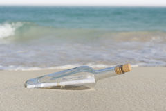 Bottle post. Stranded bottle post on a beach Royalty Free Stock Photos