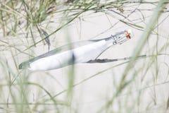 Bottle post on the beach Stock Photo