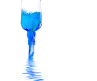 Bottle pouring blue liquid Stock Photo