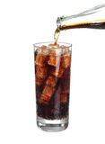 Bottle pouring coke in drink glass with ice cubes Isolated Royalty Free Stock Photos