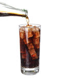 Bottle pouring coke in drink glass with ice cubes Isolated. On white background Royalty Free Stock Photography
