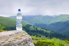A bottle of pure drinking water in plastic bottle on the mountain stock photos