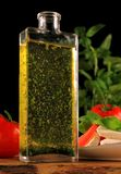 Bottle with pure oil. With herbs Stock Photo