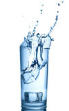 Bottle with pure water and splash around it Royalty Free Stock Image