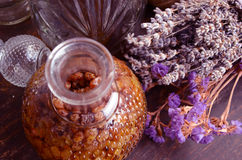 Bottle of raisins liqueur. And lavender flowers royalty free stock photos