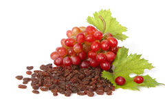 A bottle of raisins with red grapes Royalty Free Stock Photo