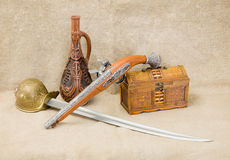 Bottle, rapier, sword, pistol and chest Stock Photo