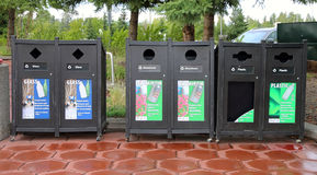 Bottle recycling bins. For glass, plastic and aluminum cans in a park in Alaska Stock Photos