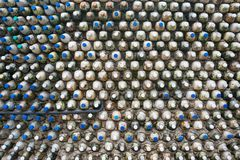 Bottle recycling - plastic bottles that form a bottle wall. Bottle recycling: plastic bottles which have been set in concrete to form a bottle wall Stock Photography
