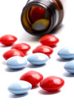 Bottle with red and blue pills Royalty Free Stock Image