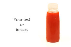 A bottle of red fresh fruit juice. With room for your text or images stock images