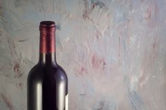 Bottle of wine on gray scenic background stock photography