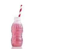 Bottle of red lemonade or juice and striped straws Royalty Free Stock Image