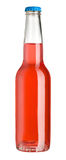Bottle of red liquid Stock Images