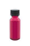 Bottle of red liquid isolated Royalty Free Stock Photos