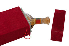 Bottle in the red velour box. Isolated on white Royalty Free Stock Photos
