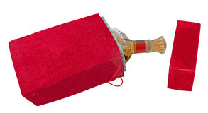 Bottle in the red velour box. Isolated on white background Stock Photography