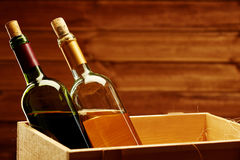 Bottle of red and white wine in wooden box Royalty Free Stock Image