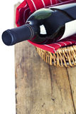 Bottle of red wine in basket Stock Images