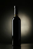 Bottle of red wine on the black background Stock Photo