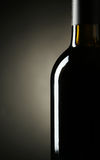 Bottle of red wine on a black Stock Image