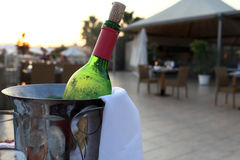 Bottle of red wine in a bucket Royalty Free Stock Images