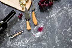 Bottle of red wine with cheese and grape aperitive on grey stone table background copyspace top view Royalty Free Stock Photos