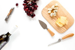 Bottle of red wine with cheese and grape aperitive on white background space for text top view. Bottle of red wine with cheese and grape aperitive on white Stock Photo
