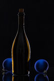 The bottle of red wine and Christmas decoration Stock Photography