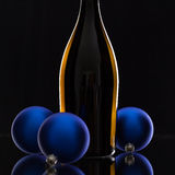 The bottle of red wine and Christmas decoration Stock Photos