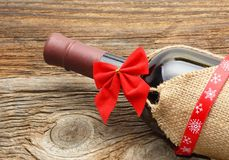 Bottle of red wine and christmas ornaments Royalty Free Stock Image