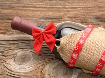 Bottle of red wine and christmas ornaments Royalty Free Stock Images