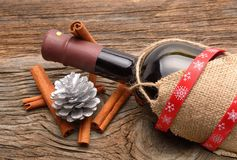 Bottle of red wine and christmas ornaments Stock Images